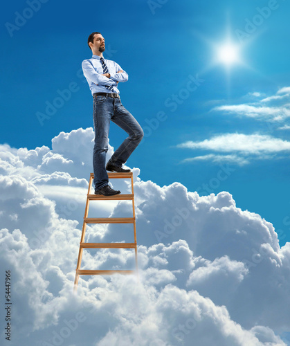 businessman standing at the top of ladder high in the sky