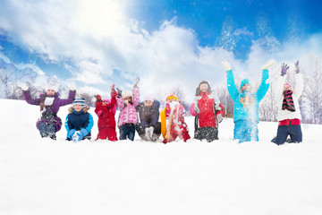 Group of kids throwing snow in the air