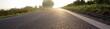 weg zum ziel - landstraße und sonnenaufgang - optimismus - 54448736