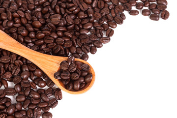 Coffee beans and wood spoon