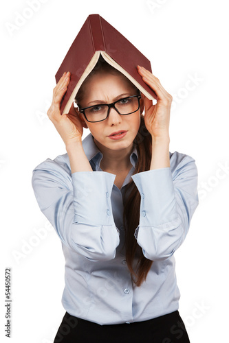 Unhappy girl holding a book over his head