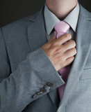 Young Adult Man in Gray Suit and Pink Tie poster
