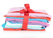 Pile of clothing with red ribbon and bow isolated on white