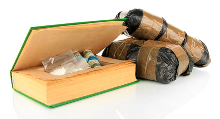 Narcotics in book-hiding place and packages isolated on white