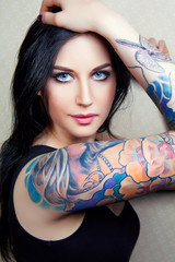 beautiful young woman with a tattoo.