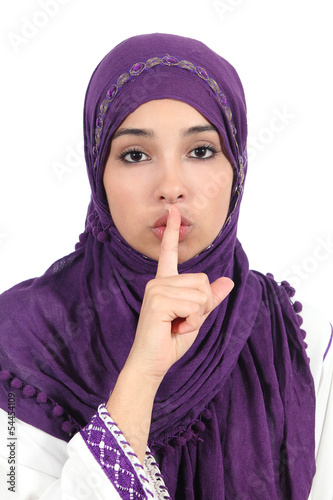 Beautiful islamic woman wearing a hijab asking for silence