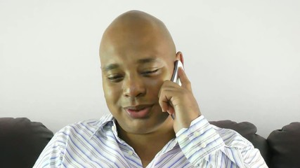 Businessman using a mobile phone at home