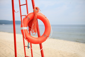 Lifeguard beach rescue equipment orange lifebuoy