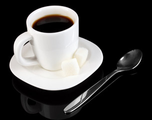 A cup of strong coffee isolated on black