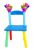 Small and colorful chair with baby mittens isolated on white