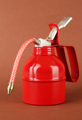 Red oil can, on color background
