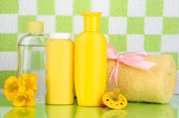 Baby cosmetics and towel in bathroom