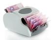 Постер, плакат: Machine for counting money with Ukrainian money isolated