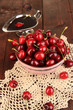 Ripe red cherry berries in bowl and chocolate sauce