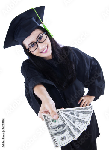 Beautiful graduate holding money - isolated