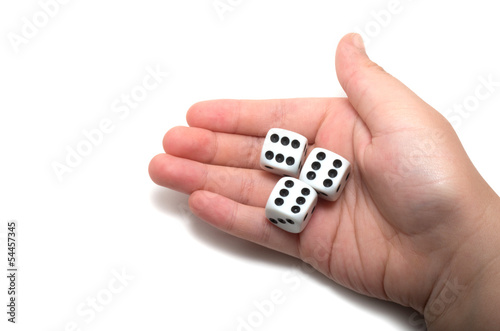 Hand holding three dices