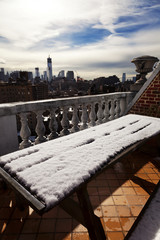 Snow Covered Picnic Table & New-York Skyline