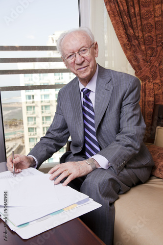Senior Businessman Smiling to Camera