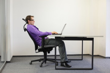 relaxed position at laptop