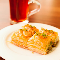 Oriental sweets baklava served with cup of tea