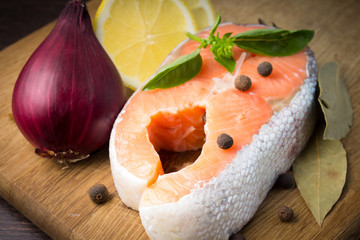 Fresh Salmon Steak on wooden Cutting Board