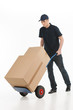 Moving house. Full length of young deliveryman with a hand truck