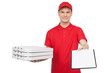 Pizza man at work. Young cheerful pizza man holding a stack of p