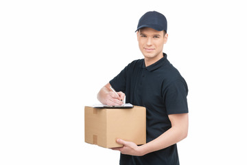 Confident deliveryman at work. Cheerful young deliveryman holdin