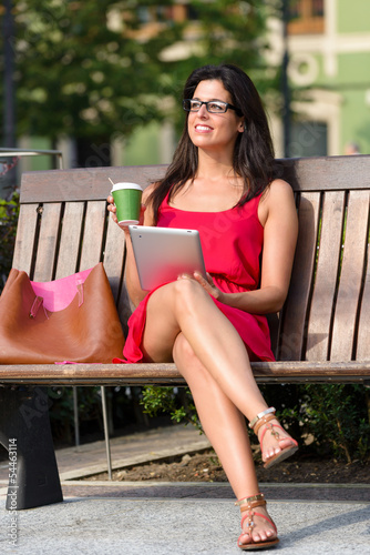 Woman with tablet and coffee