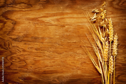 Different types of cereals displayed on vintage wood background