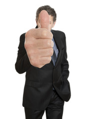 Businessman going thumbs up