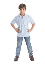 Boy Standing With Hands On Hip Against White Background