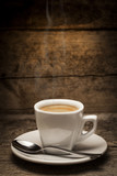 Coffee cup over a wooden background