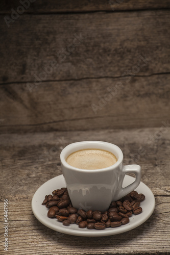 Deurstickers Cafe Coffee cup over a wooden background