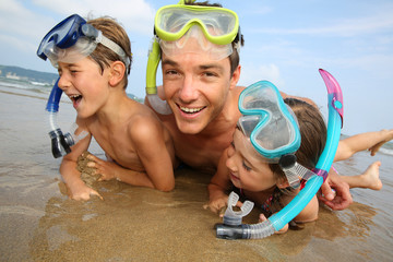 Portrait of father and children wearing diving mask