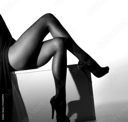 Black and white photo of sexy female legs in stockings