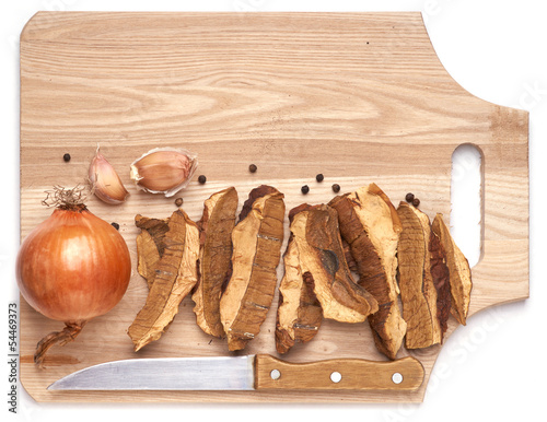 Dried Cepes. Ingredients for cooking on wood board.