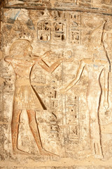 Ancient Egyptian hieroglyphic carving in Medinet Habu