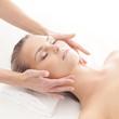 Portrait of a woman relaxing on a head massage procedure