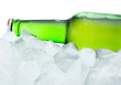 Close-up Green Bottle with Condensation cool in ice isolated on