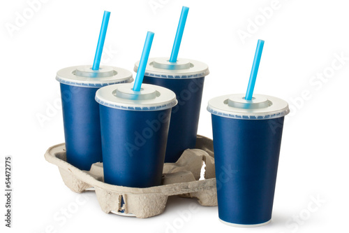 Four dark blue takeout cups with a cup holder