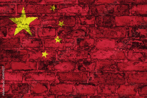 Chinese flag graphic on brick wall background