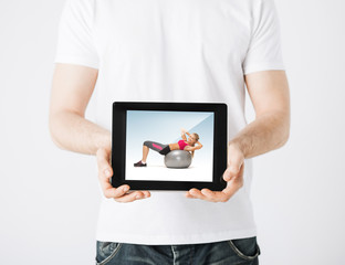 man with tablet pc and sporty woman