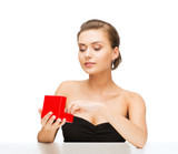 woman with diamond earrings and gift box