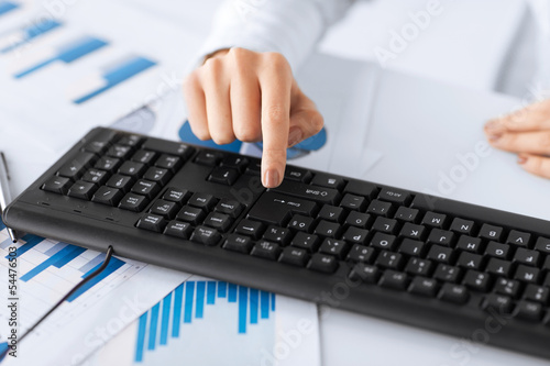 woman hand pressing enter button on keyboard