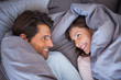 Couple having fun wrapped in their blanket