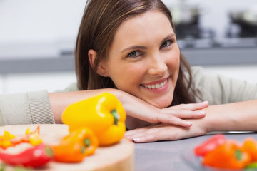 Woman leaning on the counter  of her kitchen