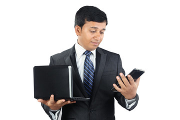 Indian Businessman with Laptop and Tablet