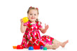 kid girl playing with cup toys
