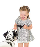 child girl feeding dog